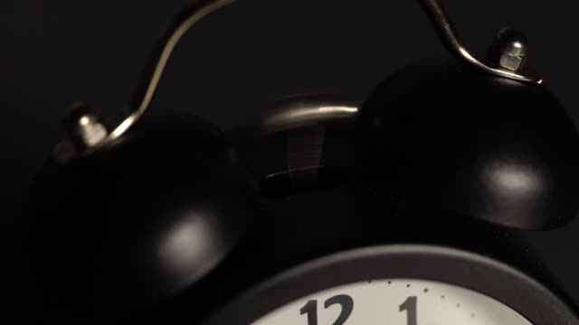 Close up of a twin bell alarm clock ringing