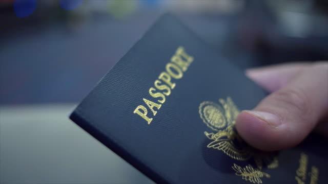 close up of a united states passport. - パスポート点の映像素材/bロール