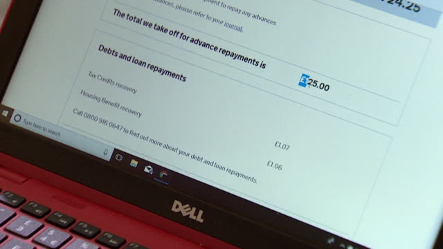 close up of a universal credit loan statement on a laptop screen - bank statement stock videos & royalty-free footage