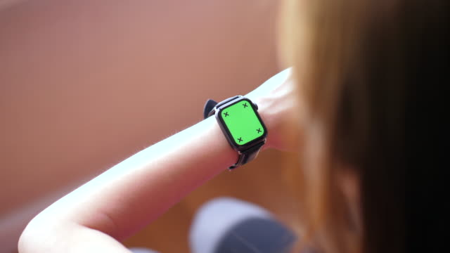 close up of a woman checking a smartwatch - wrist stock videos & royalty-free footage