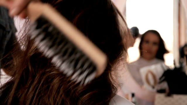Close up of a woman having a hair treatment at hairdresser's.