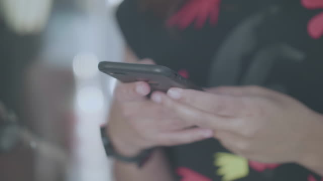 close up of a woman's hand holing and using a mobile phone - holing stock videos & royalty-free footage