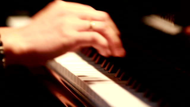 close up of a womans hand playing piano - piano stock videos and b-roll footage
