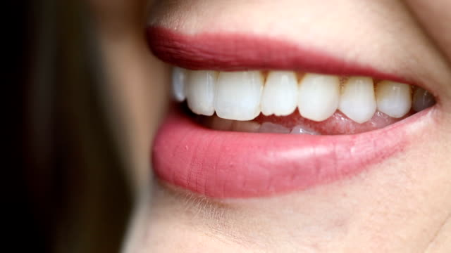 close up of a woman's smile - teeth stock videos & royalty-free footage