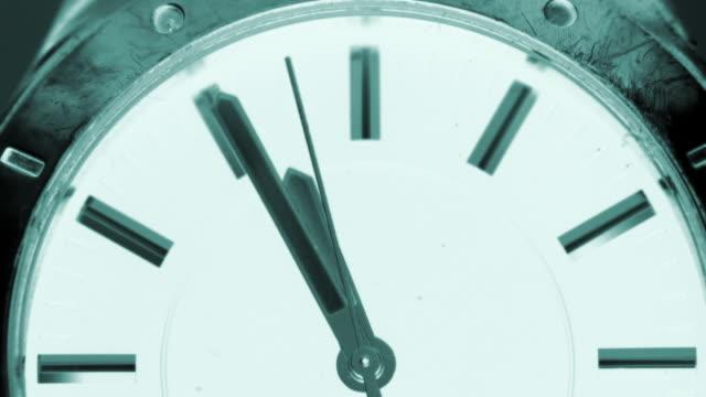 close up of a working wristwatch: time concept - 極端なクローズアップ点の映像素材/bロール