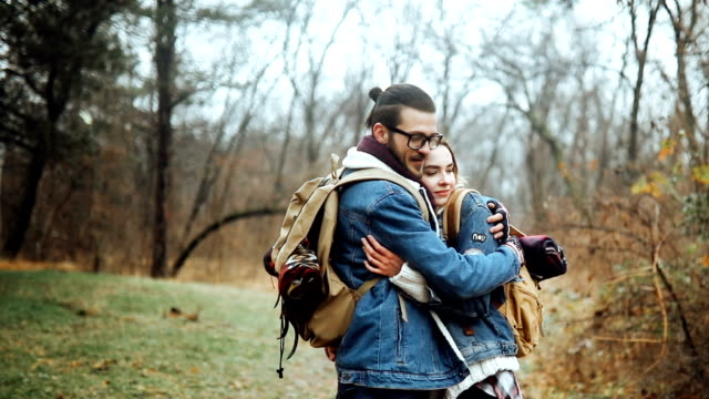 Close up of a young couple hugging in forest