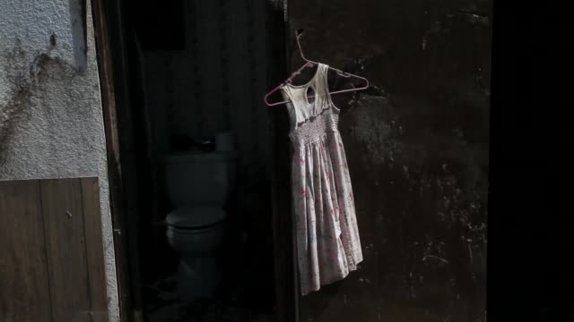 vídeos y material grabado en eventos de stock de close up of a young girls dress hanging amongst rubble family and friends help fred horn and his wife joann horn salvage items from their home after... - rasgado