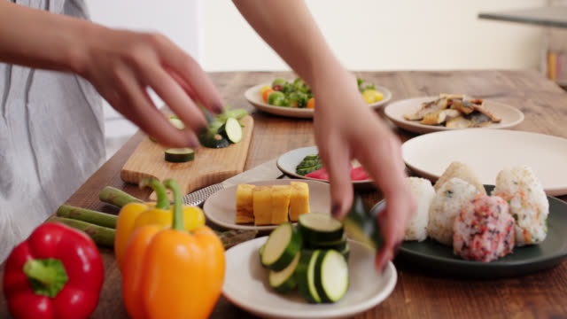 close up of a young woman preparing food - healthy eating stock videos & royalty-free footage