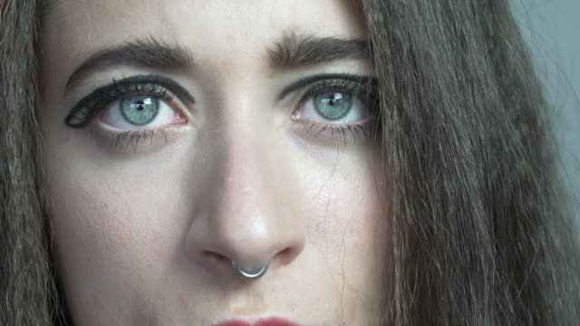 a close up of a young woman's bright blue eyes. - crimped hair stock videos and b-roll footage