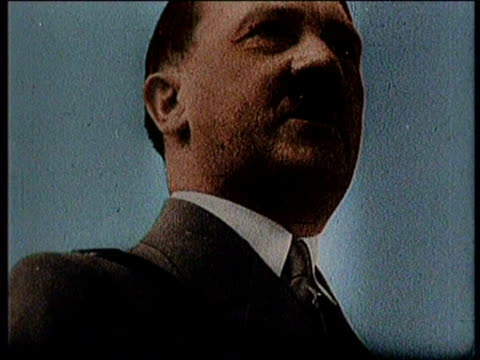 vídeos de stock, filmes e b-roll de close up of adolf hitler delivering a speech / military men line up a grab guns from a rack / soldiers marching together / a large crowd of men in... - adolf hitler