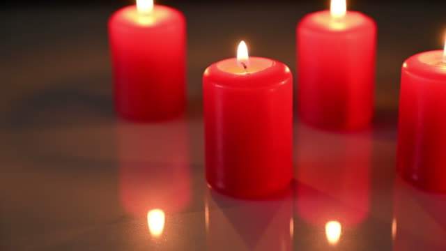 Close up of advent candles with a lit flame. Christmas time