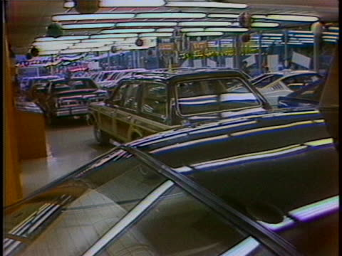 special introductory offer/ $300/ participating shot zooms out to show the front of a red chrysler sedan cut to medium shot of three people in a... - sedan stock videos & royalty-free footage