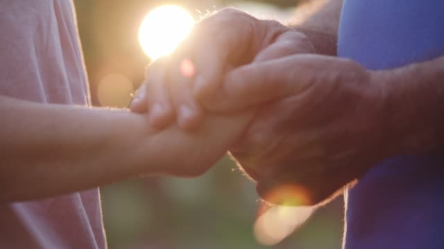 close up of affectionate senior couple holding hands - married stock videos & royalty-free footage
