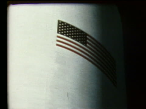 close up of american flag painted on side of rocket - 1969年点の映像素材/bロール