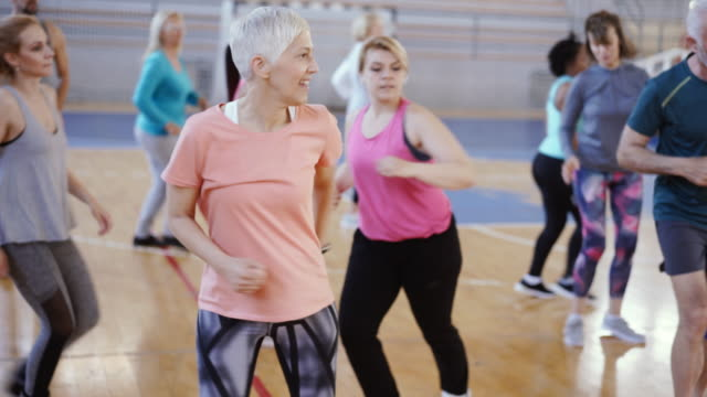 close up of an active senior woman dancing in gym - activity stock videos & royalty-free footage