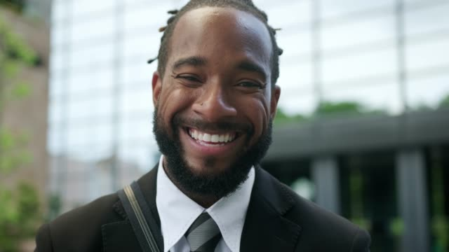 close up of an african american businessman on the street - beard stock videos & royalty-free footage