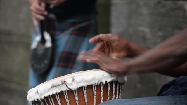 close up of an african drum street entertainers perform on edinburgh's royal mile during the city's festival fringe on august 21 2013 in edinburgh... - fringe stock videos and b-roll footage
