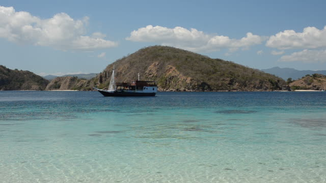 close up of an anchored boat near komodo - anchored stock videos & royalty-free footage
