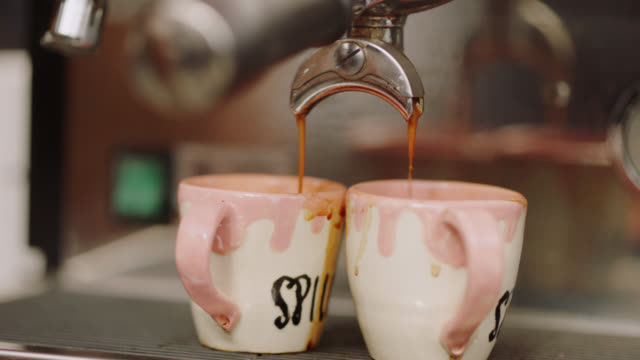close up of an espresso machine filling two small cups with espresso - cup stock videos & royalty-free footage
