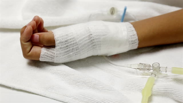 Close up of an iv drip in patient's hand