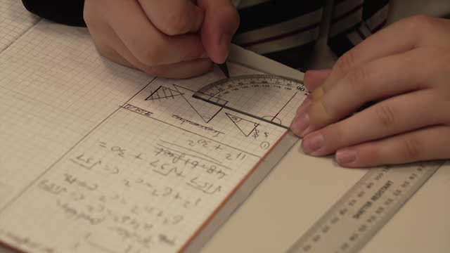 close up of anonymous schoolchildren working in maths lesson - unrecognisable person stock videos & royalty-free footage