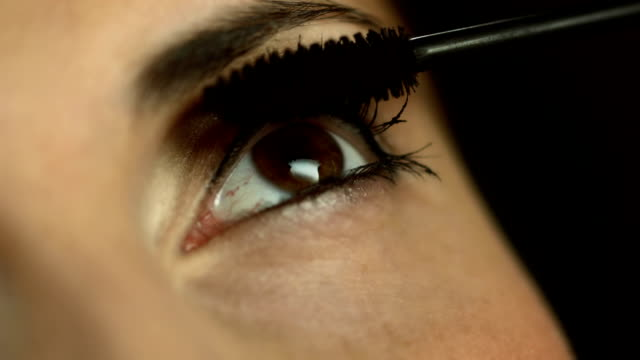 hd: close up of applying mascara - make up stock videos & royalty-free footage