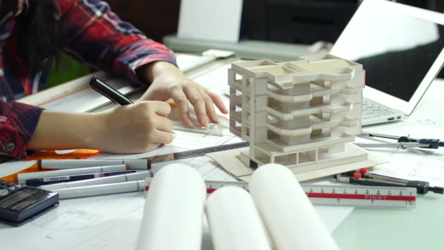 close up of architect hands drawing - architect model stock videos and b-roll footage