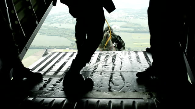 close up of army soldiers making a parachute jump from military transport aircraft - parachute stock videos & royalty-free footage
