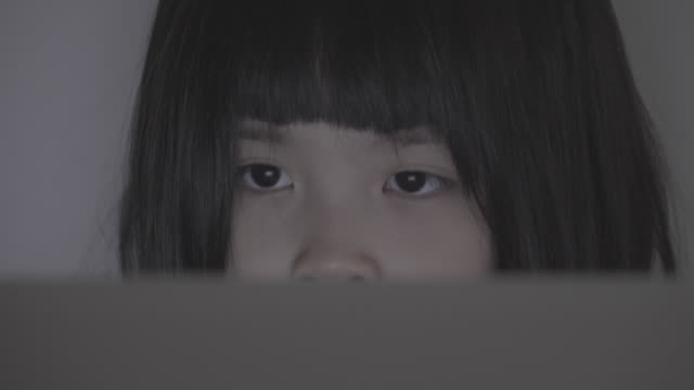 close up of asian girl using computer at home - girls flashing camera stock videos and b-roll footage