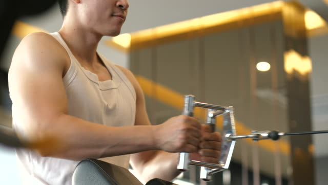 close up of asian man is exercising and pulling the equipment at the gym - cross training stock videos & royalty-free footage