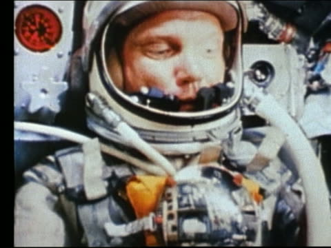 close up of astronaut in spacesuit in rocket / john glenn - nur männer über 30 stock-videos und b-roll-filmmaterial