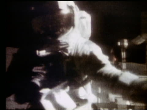 close up of astronaut jumping onto lunar rover on Moon