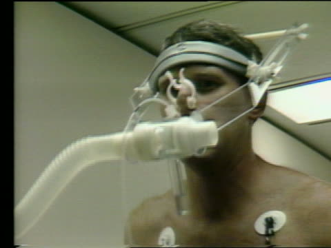 close up of astronaut with electrodes walking on treadmill