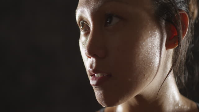 Close up of Athletic woman sweating taking a break after work out