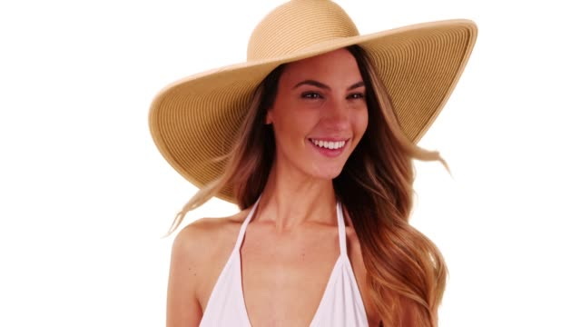 close up of attractive female in bikini modeling floppy sunhat in studio - sonnenhut stock-videos und b-roll-filmmaterial