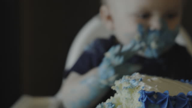 close up of baby boy with messy face eating birthday cake / pleasant view, utah, united states - messy stock videos & royalty-free footage