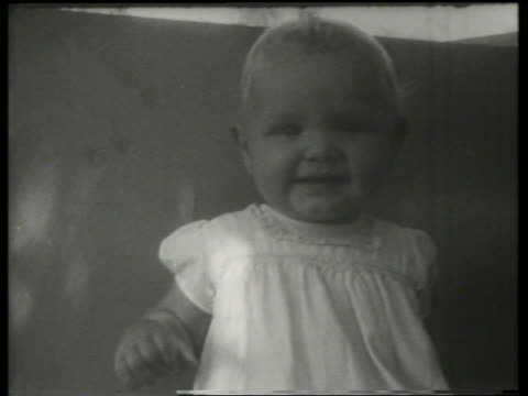 close up of baby smiling / canadian national exhibition / sound - babies only stock videos & royalty-free footage