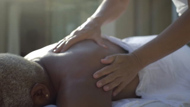 close up of back massage - massaging stock videos & royalty-free footage
