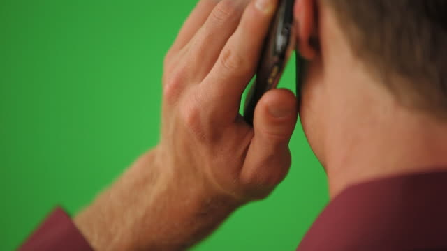 Close up of back of man on cell phone