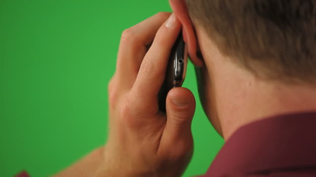 close up of back of man on cell phone - ear stock videos & royalty-free footage