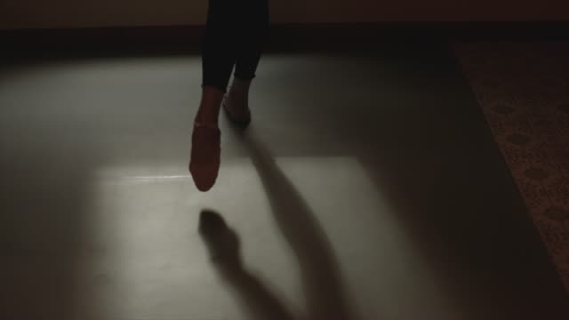 close up of ballet slippers on linoleum floor with shadow at home workout - barre stock videos & royalty-free footage