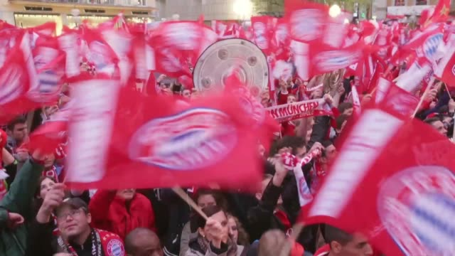 Close up of Bayern Muenchen fans celebrating the German championship title at Marienplatz on May 11 2013 in Munich Germany FC Bayern Muenchen German...
