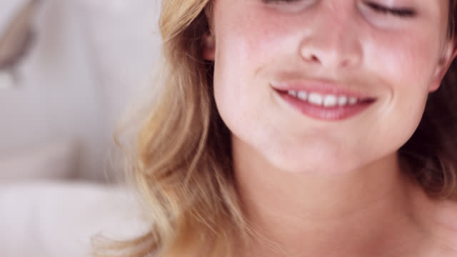 close up of beautiful blonde woman rubbing her neck after applying a skin care product. - neck stock videos & royalty-free footage