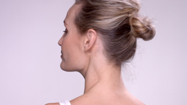 close up of beautiful mature woman spinning on the spot. - ponytail stock videos & royalty-free footage