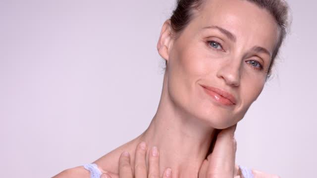 close up of beautiful mature woman. - headshot stock videos & royalty-free footage
