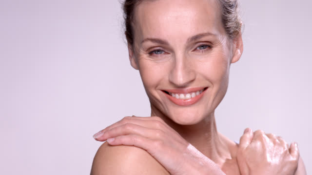 close up of beautiful mature woman with flawless skin. - arms crossed stock videos & royalty-free footage