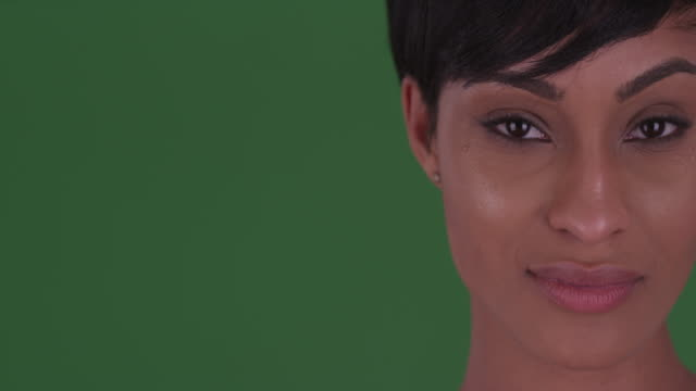 close up of beautiful woman looking at camera on green screen - raised eyebrows stock videos & royalty-free footage