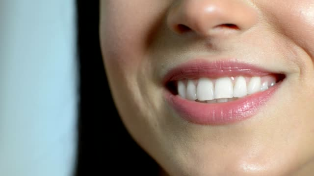 Close Up Of Beautiful Woman Smiling With Perfect Teeth