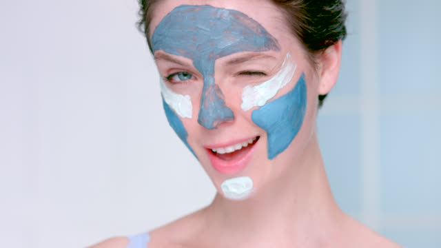 close up of beautiful woman wearing a blue clay face mask. - skin care stock videos & royalty-free footage