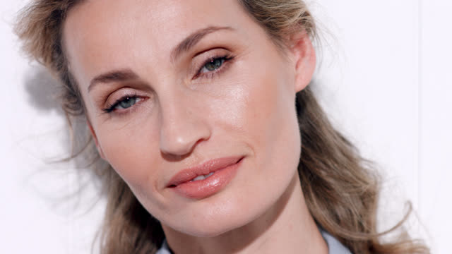 close up of beautiful woman with a glistening, bronzed make-up look. - blouse stock videos & royalty-free footage